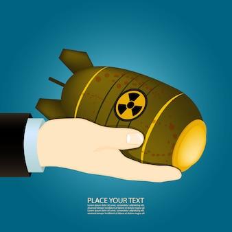 La mano sostiene una bomba nuclear.