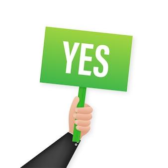 La mano sostiene el cartel con el texto yes. satisfacción, aceptación.