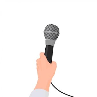La mano sostiene el micrófono. entrevista en primera persona con rueda de prensa.