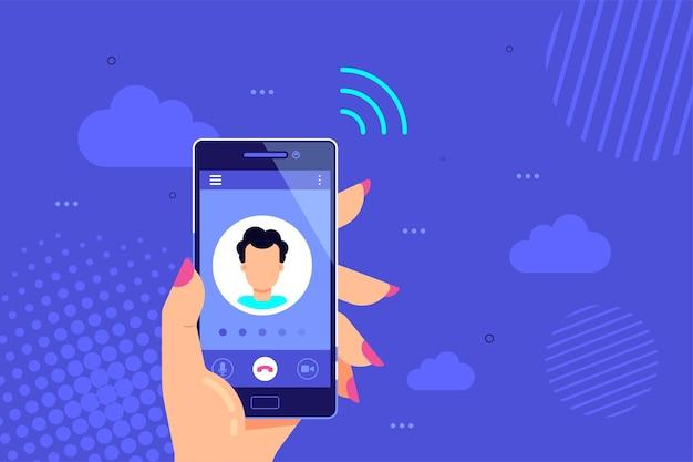 La mano sostiene el teléfono inteligente con llamada saliente en una pantalla. servicio de llamadas.