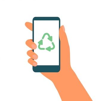 La mano sostiene el teléfono móvil con el símbolo de reciclaje verde en la pantalla. ilustración vectorial