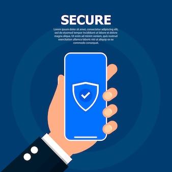 La mano sostiene el teléfono con un token de seguridad en la pantalla.