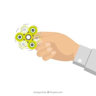 Mano con spinner amarillo girando