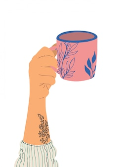 Mano con tatuaje sostiene una taza de té. vista lateral. ilustración de moda en estilo de dibujos animados. diseño gordo dibujado a mano.