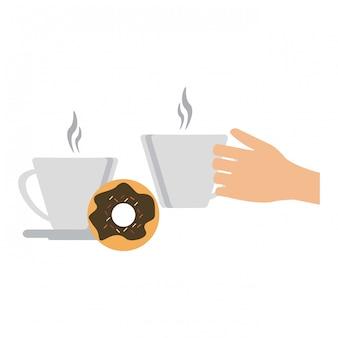 Mano con tazas de café y rosquilla.