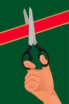 Mano con las tijeras corta la cinta roja.