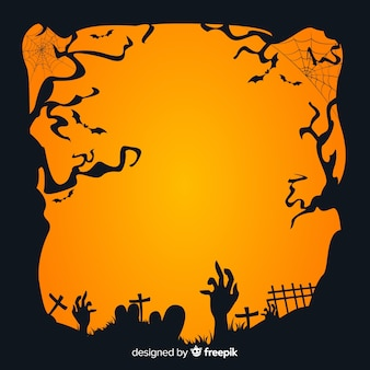 Mano de zombie en un cementerio al atardecer