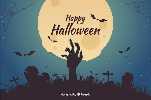 Mano de zombie en cementerio fondo de halloween