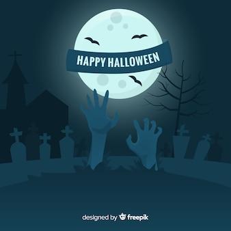Mano de zombie en cementerio sobre fondo de luna llena