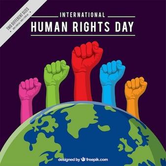Manos de colores saliendo del mundo, día de los derechos humanos