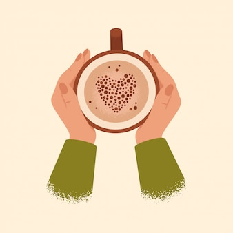 Manos femeninas que sostienen la taza de café