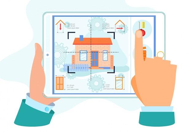 Manos humanas sosteniendo tableta con renovación del hogar