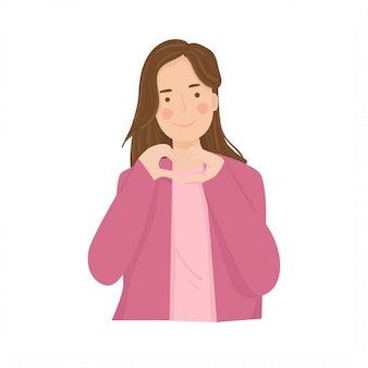 Manos de mujer haciendo una ilustración en forma de corazón