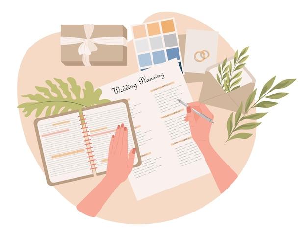 Manos de mujer de ilustración plana de planificación de bodas escribiendo notas en