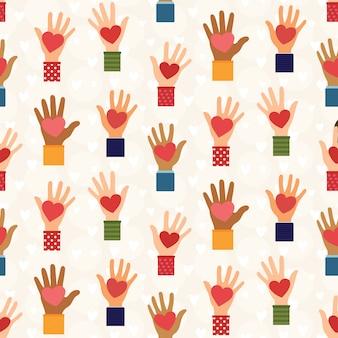 Manos con patrón de corazones - concepto de donación