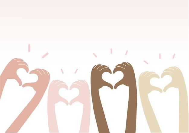 Las manos que hacen el corazón firman encima