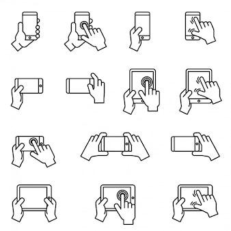 Las manos que sostienen el icono del smartphone y de la tableta fijaron con el fondo blanco. vector de stock de estilo de línea fina.