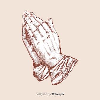 Manos rezando realistas