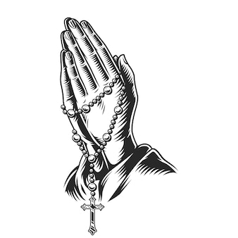 Manos rezando con rosarios
