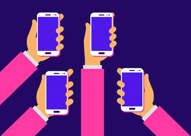 Manos con smartphones