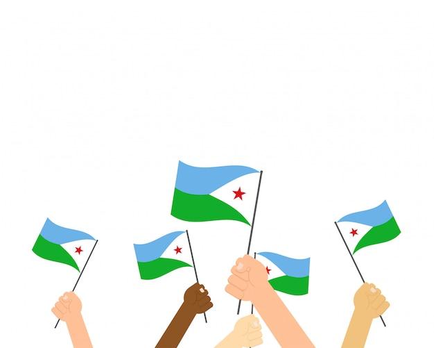 Manos sosteniendo banderas de djibouti i