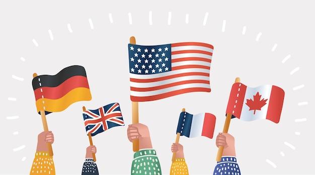 Manos sosteniendo banderas nacionales de diferentes países