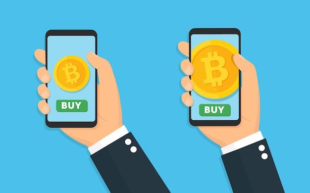 Manos sosteniendo smartphone con bitcoin en pantalla