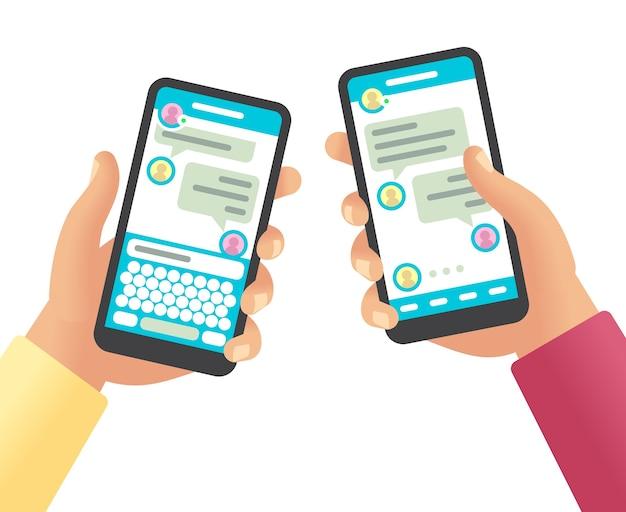 Manos sosteniendo teléfonos con mensaje. comunicación de redes sociales, aplicación de teléfono inteligente de pantalla táctil con dibujos animados de chat en línea dos teléfonos aislados