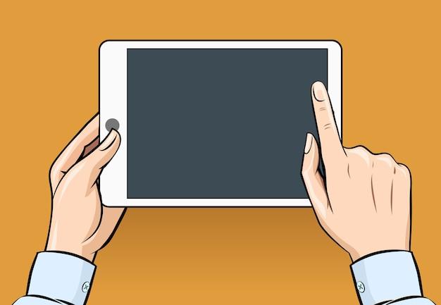 Manos sosteniendo y tocando en tableta digital en estilo vintage. comunicación e informática, internet, electrónica móvil