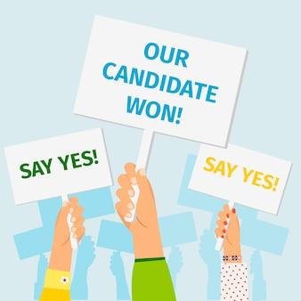 Manos sujetando carteles de la elección presidencial.