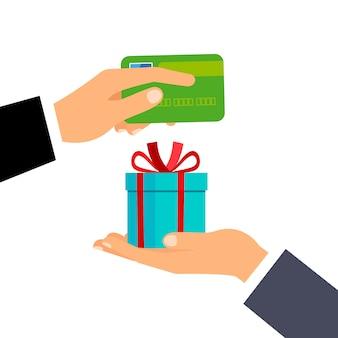 Manos con tarjeta de crédito y regalo.