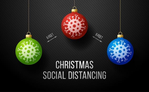 Mantener la distancia social banner de feliz navidad con bola de árbol realista.