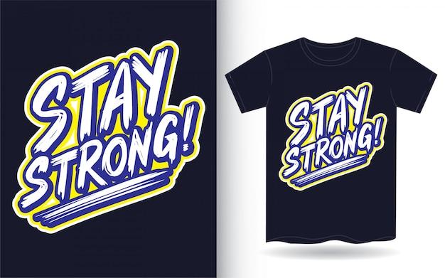 Mantente fuerte lema de letras de mano para camiseta