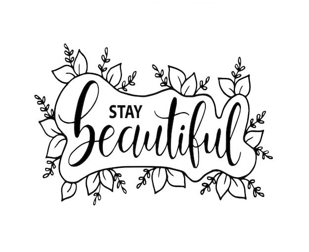 Mantente hermosa, letras a mano con flores de marco