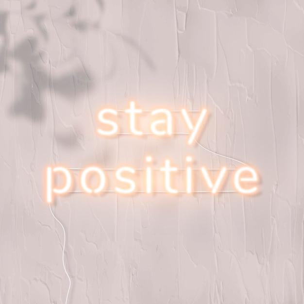 Mantente positivo en la palabra de neón