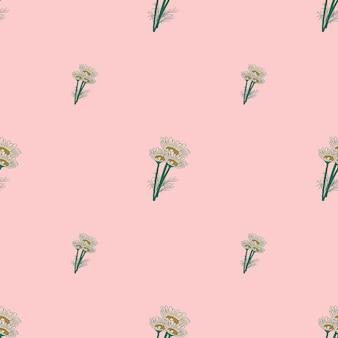 Manzanilla de patrones sin fisuras sobre fondo rosa. hermoso adorno de flores de verano.