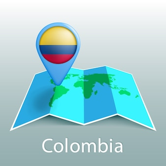 Mapa mundial de la bandera de colombia en el pin con el nombre del país sobre fondo gris