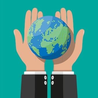 Mapa del mundo silueta. globo en mano