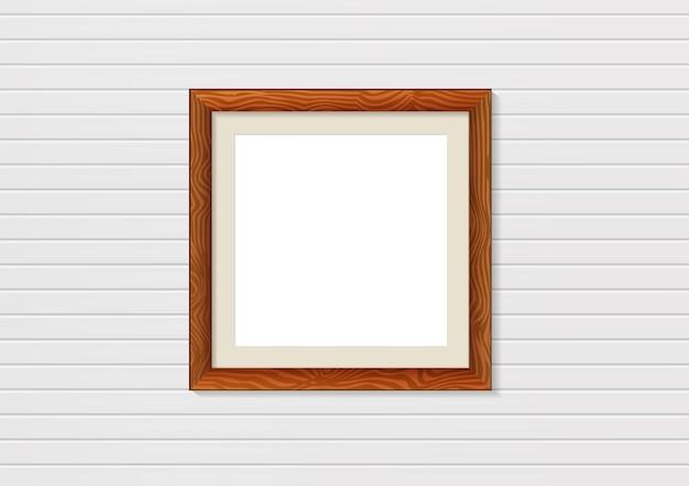 Maqueta de marco de fotos de madera en la pared. decoración de interiores