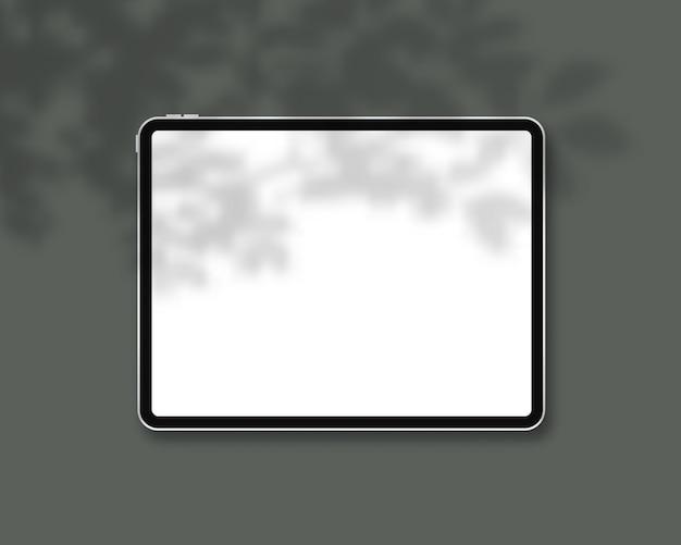 Maqueta de tableta realista con superposición de sombras.
