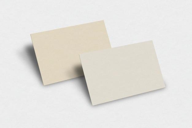 Maqueta de tarjeta de visita en blanco en tono dorado claro con vista frontal y trasera