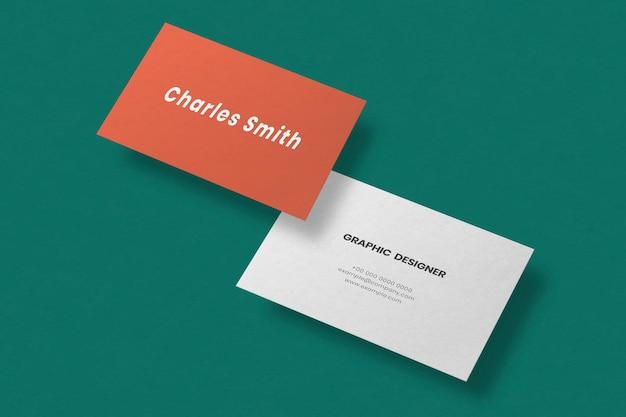 Maqueta de tarjeta de visita simple en naranja y blanco con vista frontal y trasera