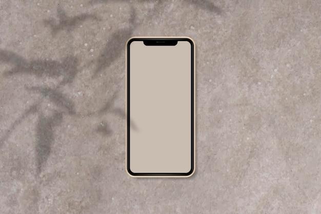 Maqueta de teléfono sobre fondo de mármol marrón