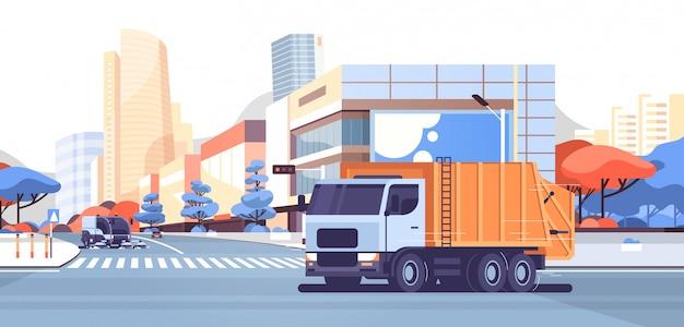 Máquina barredora de calles y camión de basura
