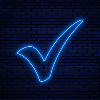 Marca de verificación de neón azul. marca de verificación de neón aislada sobre fondo de pared de ladrillo.