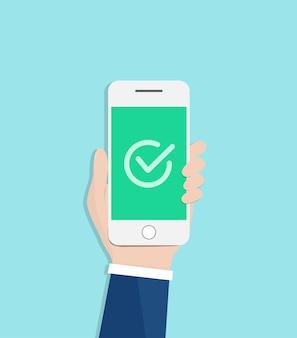 Marca de verificación en la pantalla del teléfono inteligente. mano de empresario sosteniendo smartphone.