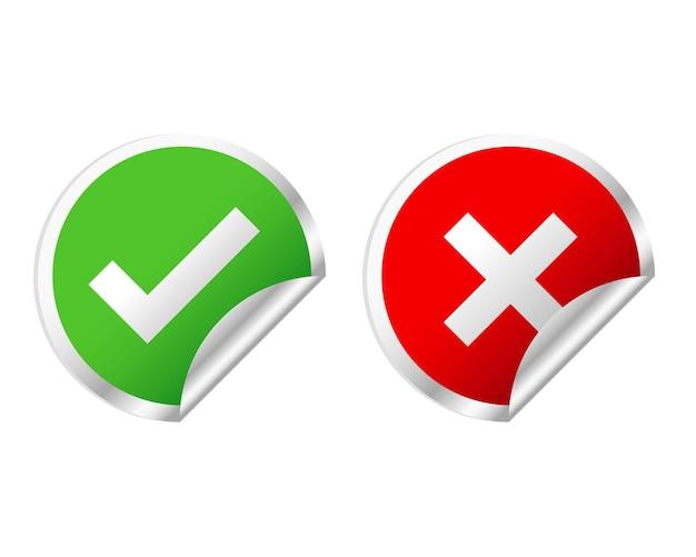 Marca de verificación verde y pegatinas de cruz roja