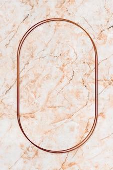 Marco de bronce ovalado sobre fondo de mármol naranja