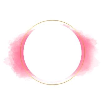 Marco de círculo dorado con forma de acuarela rosa