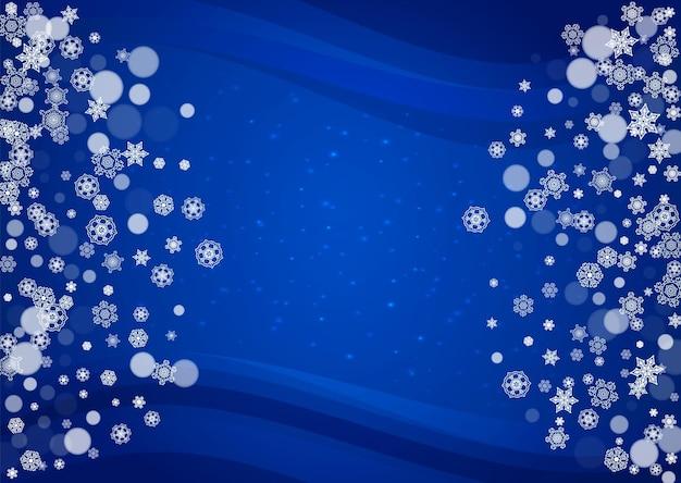 Marco de copos de nieve sobre fondo azul horizontal con destellos. feliz navidad y próspero año nuevo. marco de copos de nieve cayendo para pancartas, tarjetas de regalo, invitaciones a fiestas y ofertas comerciales especiales